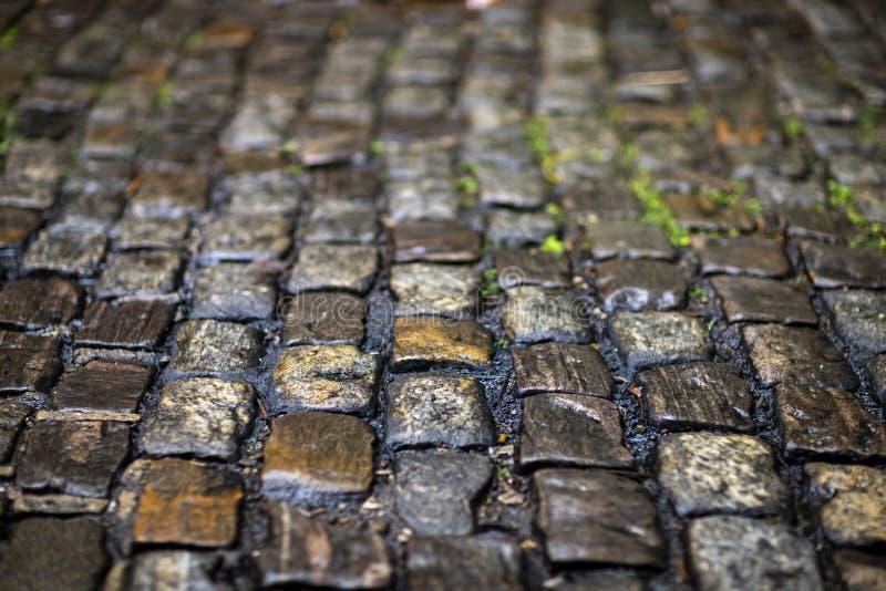 Steinpflasterungsbeschaffenheit Cobblestoned Plasterungshintergrund des Granits stockfotografie