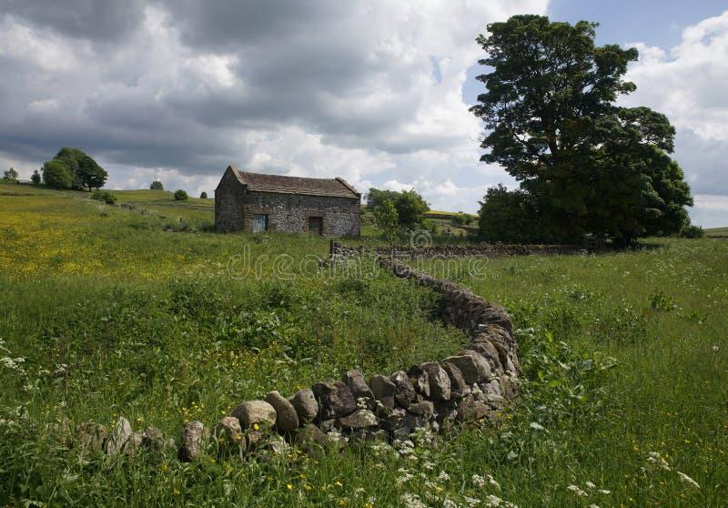 Steinscheune in England stockbilder