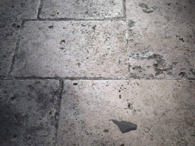 Steinstrukturboden im Grau stockbild