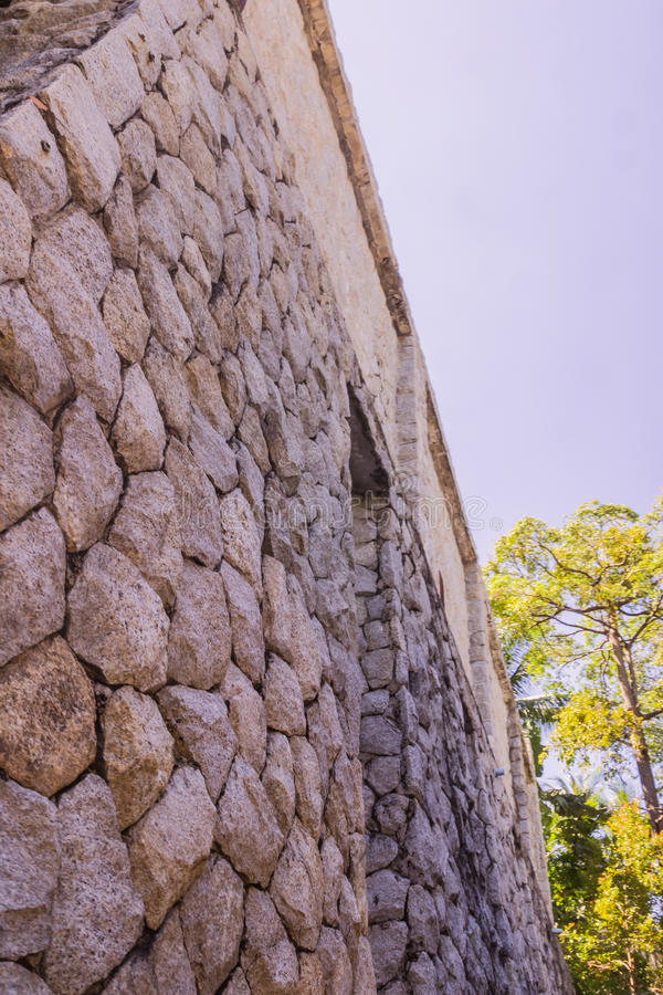 Steinwand des Landhauses stockfotografie