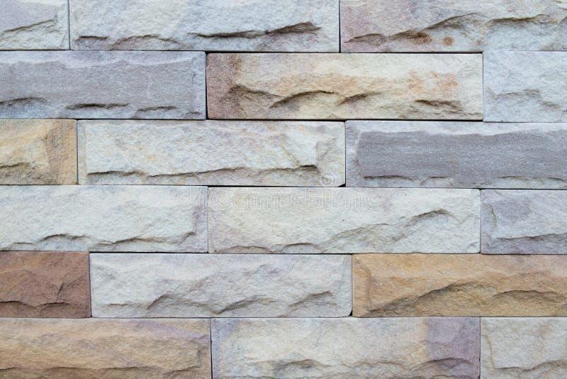 Steinwand-Reihenbeschaffenheitshintergrund stockbild