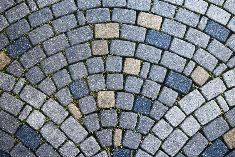 Steinweg an der alten Stadt in Europa Beschaffenheit, Abschluss oben Auszug strukturierter Hintergrund lizenzfreies stockfoto