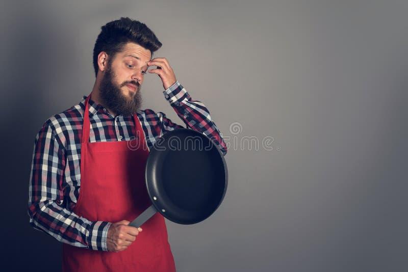 steka male panna för kock fotografering för bildbyråer