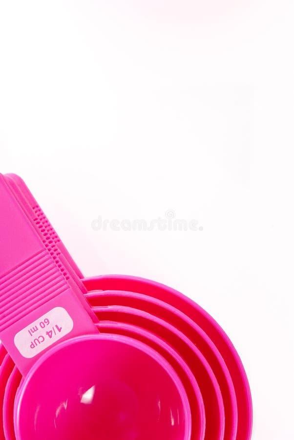 stekheta rosa plastic utensils royaltyfri foto