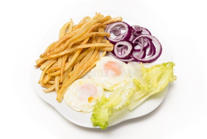 Stekte ägg med olika grönsaker arkivfoton