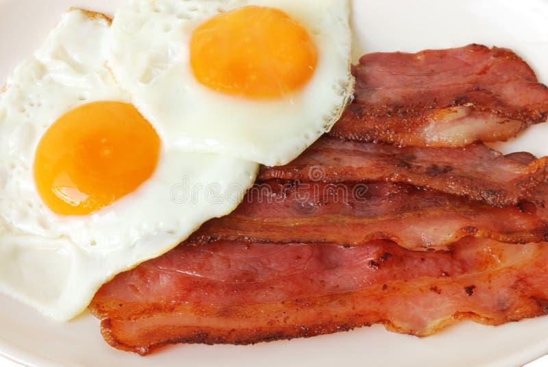 stekte baconägg royaltyfria foton