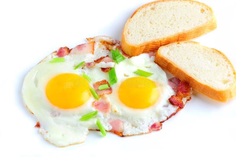 stekte baconägg royaltyfri fotografi