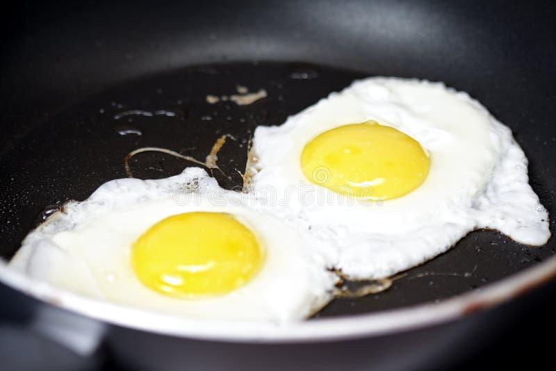 stekte matlagningägg royaltyfri fotografi