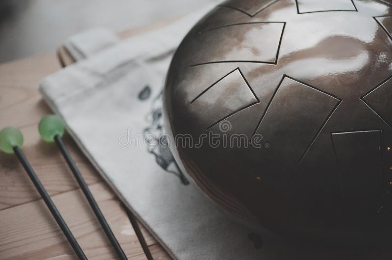 Stell Tongue Drum with Drum Sticks. Tank Drum royalty free stock photo