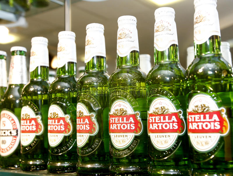 Stella Artois beer bottles at the bar royalty free stock photo
