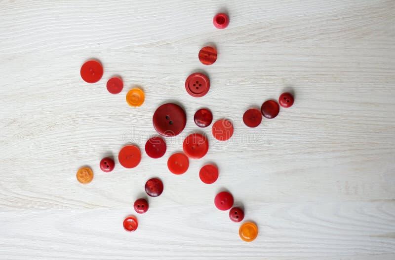 Stella dei bottoni rossi fotografia stock