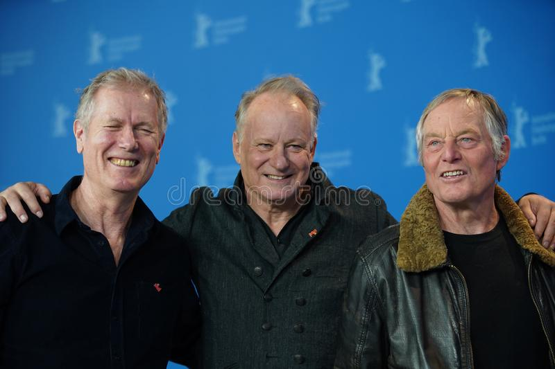 Stellan Skarsgard, Hans Petter Moland attend the `Out Stealing Horses. ` Photocall at the 69th Berlinale International Film Festival Berlin on February 9, 2019 royalty free stock images