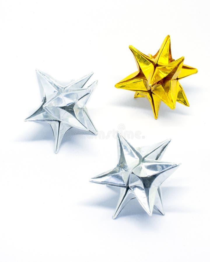 Stelle di origami dell'argento e dell'oro immagine stock libera da diritti