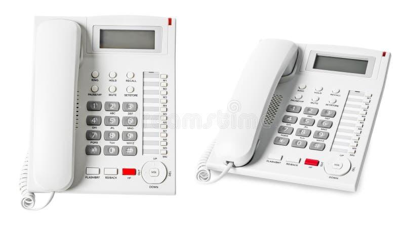 Stellen Sie vom weißen IP-Telefonbüro ein, das auf weißem Hintergrund lokalisiert wird stockfotos