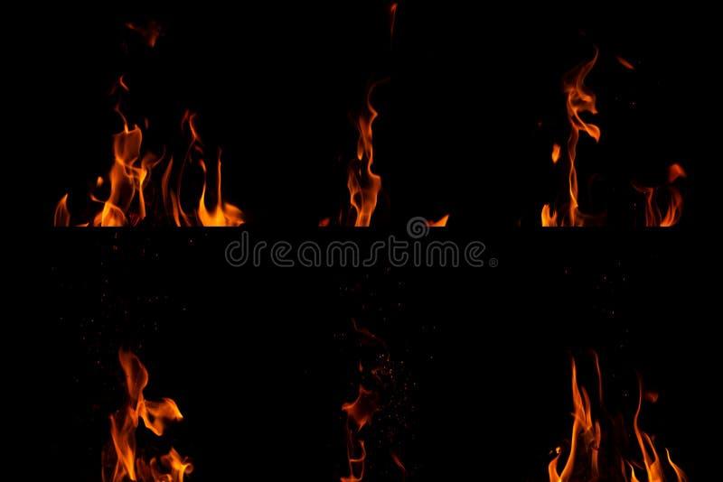 Stellen Sie von den Feuerflammen auf schwarzem Hintergrund ein lizenzfreie stockfotos