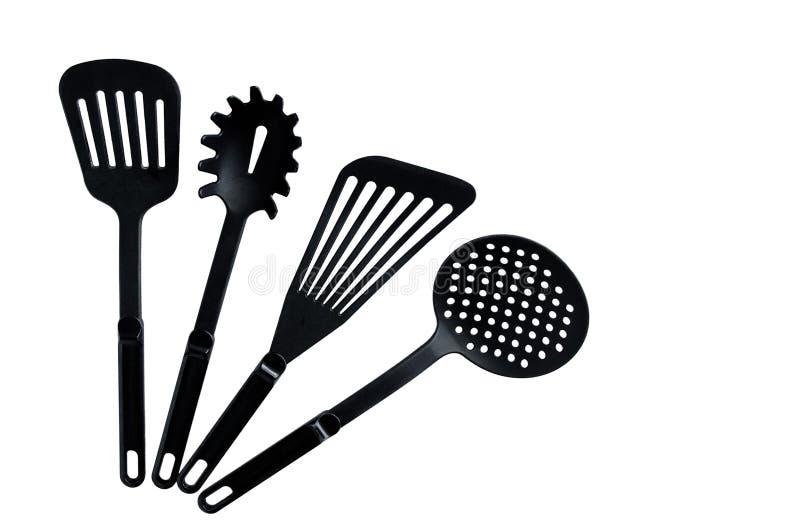 Stellen Sie von den schwarzen Tellern für das Kochen ein stockfoto
