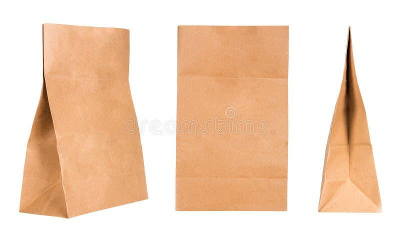 Stellen Sie von drei Kraftpapier-Papiertüten auf weißem Hintergrund ein lizenzfreies stockbild