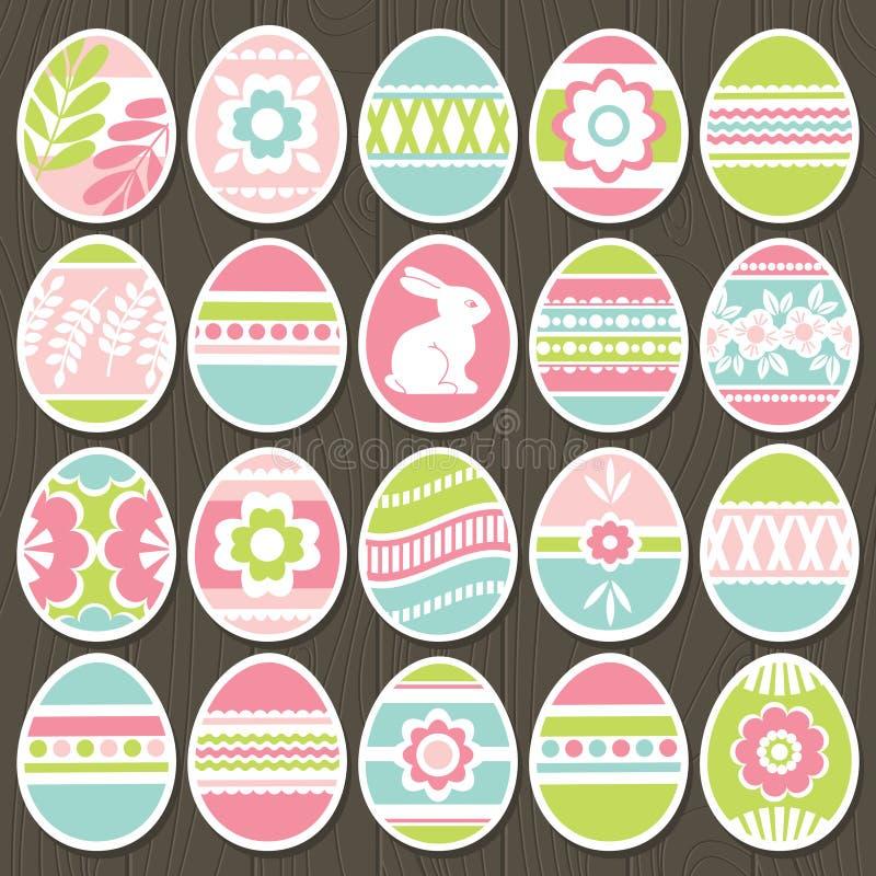 Stellen Sie von Farb-Ostereiern über braunem hölzernem Hintergrund ein Feiertags-Easter Eggs verziert mit Blumen, Kaninchen, Blät lizenzfreie abbildung