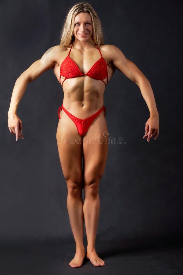 Stellende bodybuilder stock foto