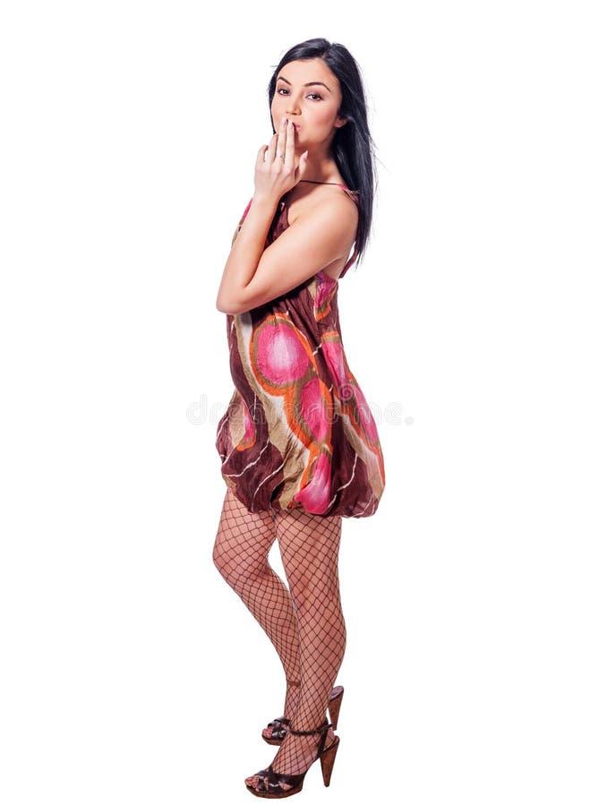 Stellung der jungen Frau stockfotografie