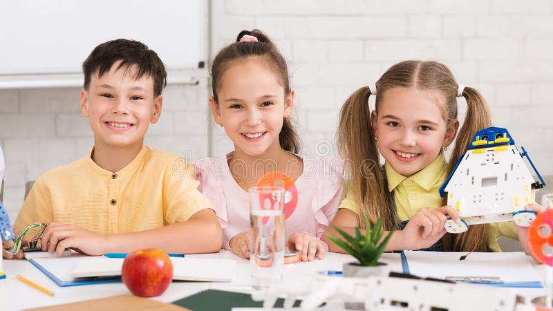 Stem education. Children building robots in classroom. Stem education. Children building robots in after school stem class, panorama stock image