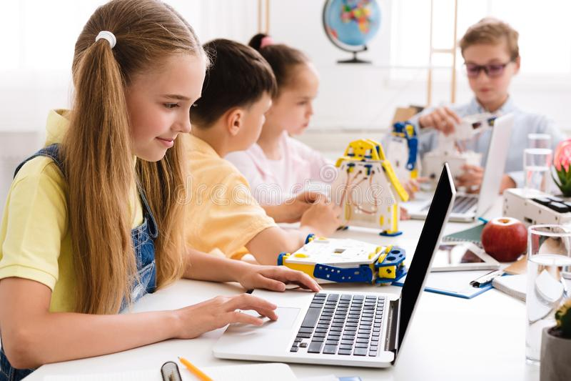 Stem education. Girl programming diy robot with laptop. Studying modern technologies royalty free stock photography