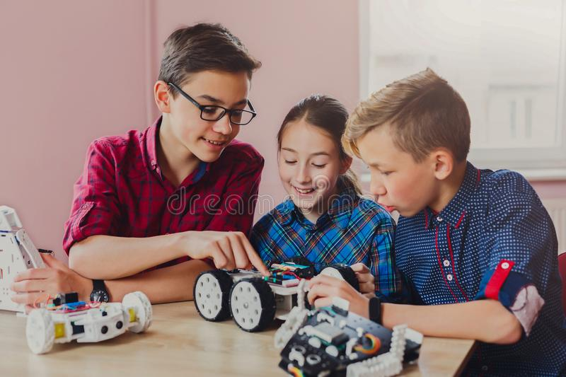 Stem education. Kids creating robots at school stock photos