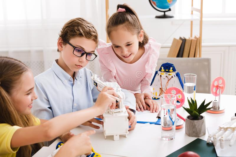 Stem education. Kids creating robots at school royalty free stock image
