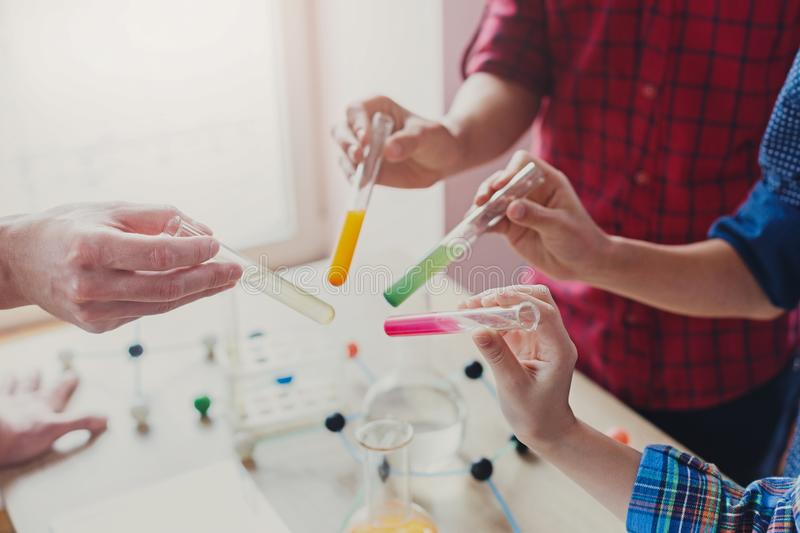 Pupils doing biochemistry research, stem education stock images
