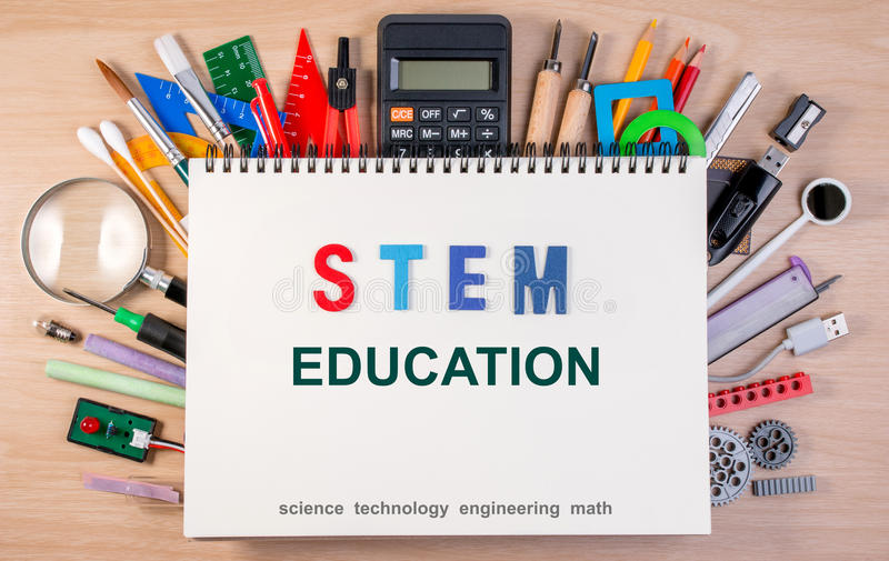 STEM education text on notebook over school supplies or office s stock images