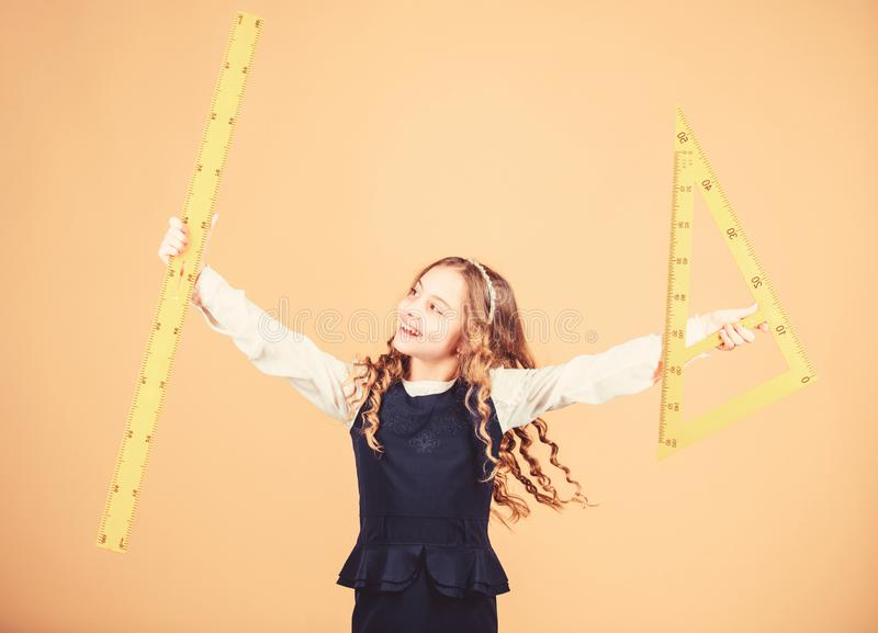 STEM school disciplines. small girl back to school. math lesson. Education and knowledge. Pupil girl with big rulers royalty free stock photo