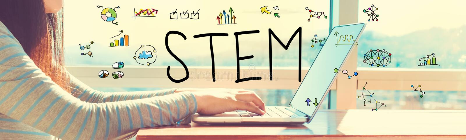 STEM with woman working on a laptop. In brightly lit room royalty free stock photography