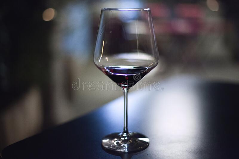 Stemmed glass on bar royalty free stock photography