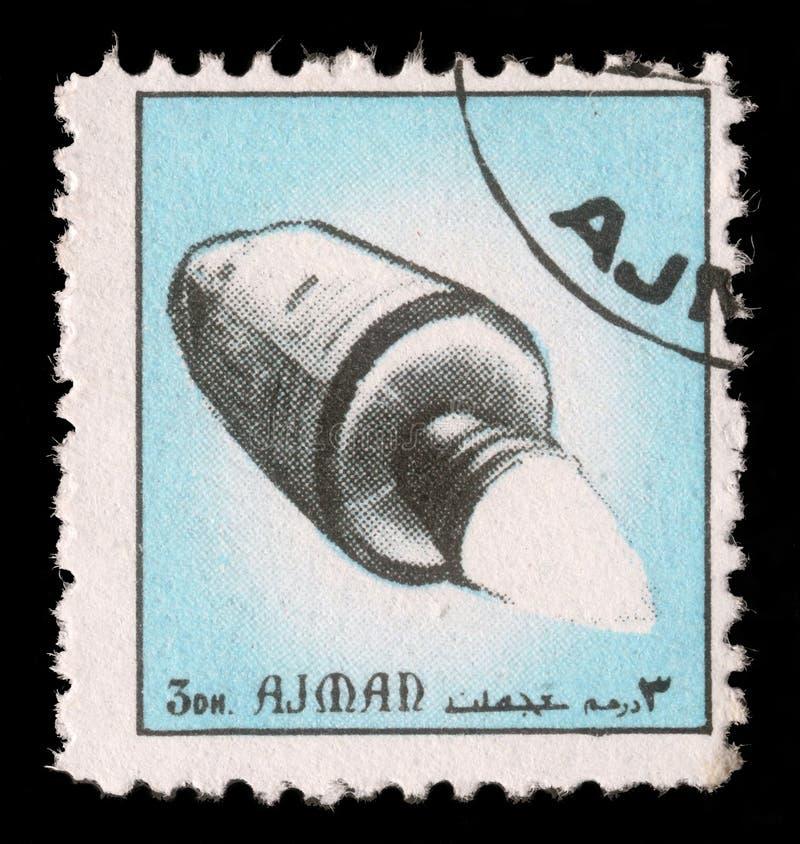 Stempel gedruckt im Emirat Adschman-Showraumschiff lizenzfreies stockfoto
