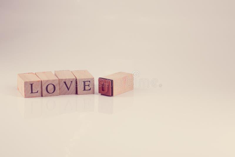 Stemplujący bloku abecadła miłości TY przeliterowany, rocznika styl zdjęcia stock