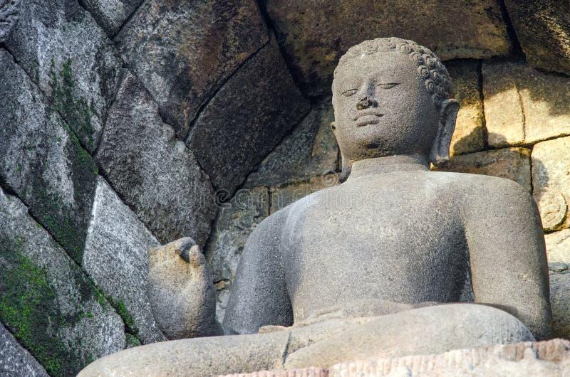 Sten buddha Borobudur Indonesien royaltyfri bild