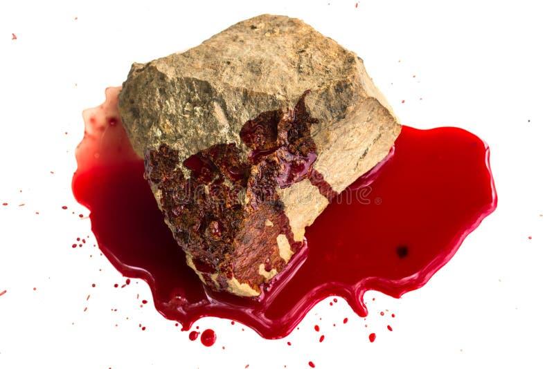 Sten och blod på vit arkivfoto