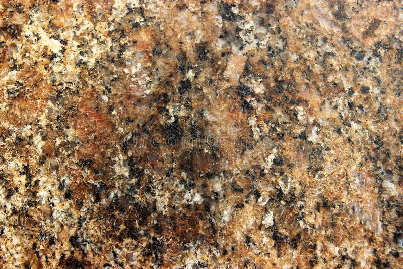 Stena igneous bakgrund av fläckig granit vaggar använt för kökworktops etc arkivbild