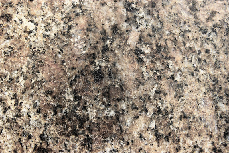 Stena igneous bakgrund av fläckig granit vaggar använt för kökworktops etc arkivbilder