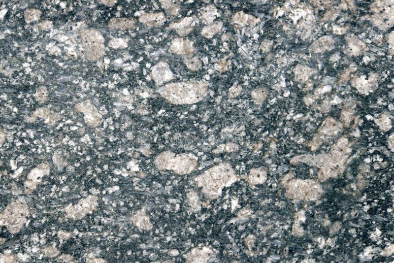 Stena igneous bakgrund av fläckig granit vaggar använt för kökworktops etc royaltyfri bild