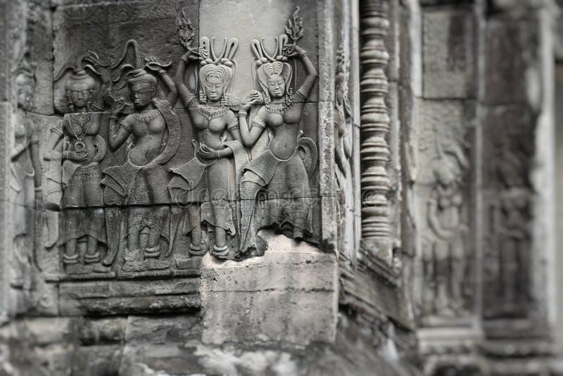 Stena väggmålningar och skulpturer i Angkor Wat, Cambodja arkivbild