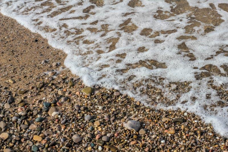 Stenar på sanden royaltyfri fotografi