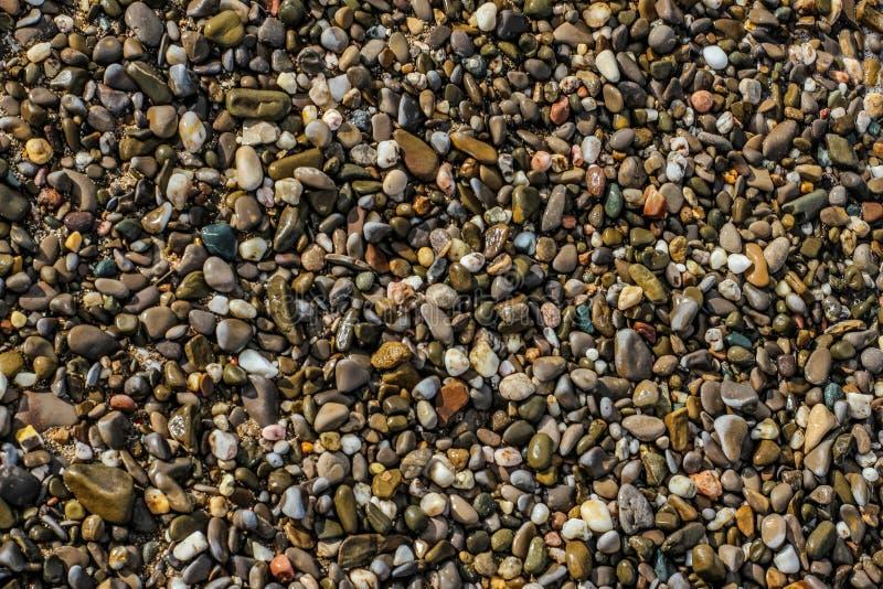 Stenar på sanden arkivfoto