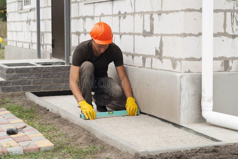 Stenditura delle lastre per pavimentazione immagine stock