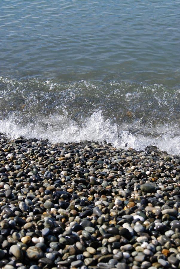 Stenen op het strand stock foto's