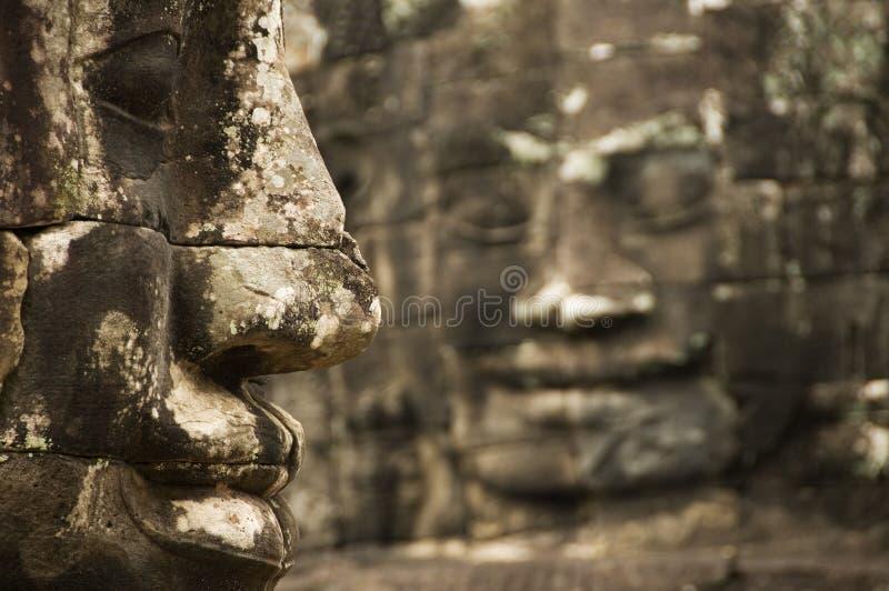 Stenen vänder mot, det Bayon tempelet, Angkor Wat, Cambodja royaltyfri foto