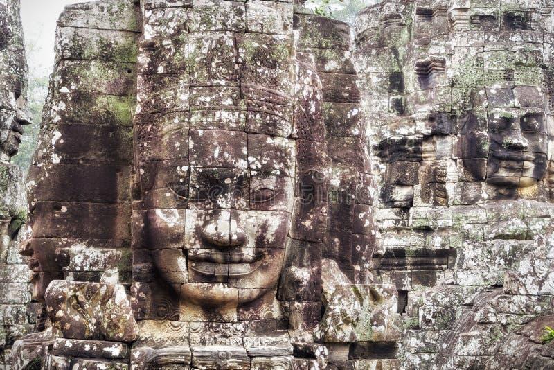 Stenframsidor på den Bayon templet på Angkor, Siem Reap, Cambodja royaltyfri foto