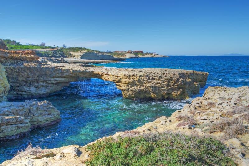 Stenig kust i Porto Torres royaltyfria bilder