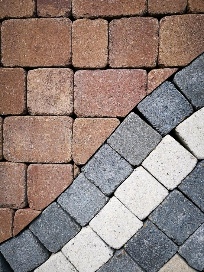 Stenläggningstenar - olika färger royaltyfri bild