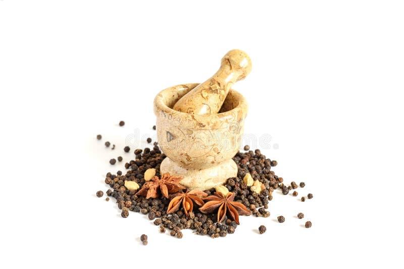 Stenmortel och mortelstöt med kryddan royaltyfri bild